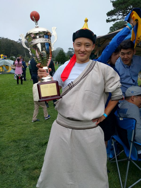Ganbi with basketball trophy